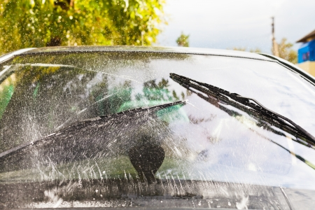wiper: outdoor view of car wipers wash windshield when driving in rain