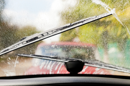 wiper: Car wipers clean windshield when driving in bad weather
