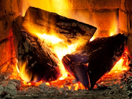 burning time: burning fuelwood in fireplace in evening time