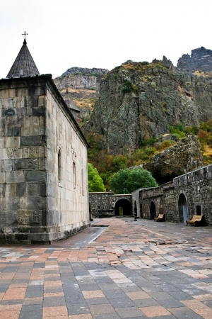cliffs and courtyard of Geghard monastery in Armenia photo