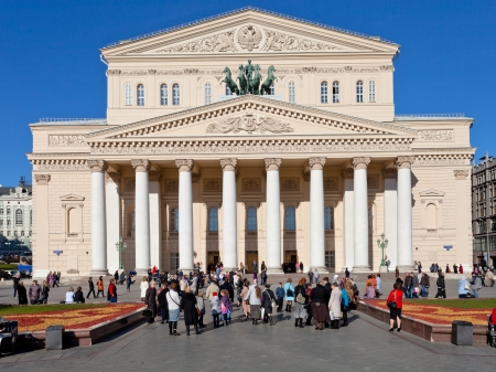 bove: MOSCOW, RUSSIA - OCTOBER 13: tourists in front of Bolshoi Theatre in Moscow, Russia on October 13, 2013. The square was designed in neoclassical style by Joseph Bove 1820s years