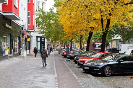 str: BERLIN, GERMANY - OCTOBER 15: people on Potsdamer Strasse in Berlin, Gemany on October 15, 2013. The Potsdamer Strasse is part of the former king road from Aachen to Konigsberg.