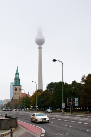 BERLIN, GERMANY - OCTOBER 16: Karl-Liebknecht-Strasse, Marienkirche and Fernsehturm TV Tower in Berlin, Germany on October 16, 2013. Karl-Liebknecht-Strasse is major street in German capital Berlin
