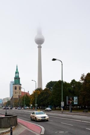 str: BERLIN, GERMANY - OCTOBER 16: Karl-Liebknecht-Strasse, Marienkirche and Fernsehturm TV Tower in Berlin, Germany on October 16, 2013. Karl-Liebknecht-Strasse is major street in German capital Berlin