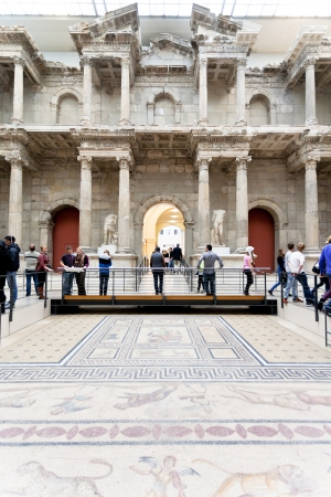 BERLIN, GERMANY - OCTOBER 16: tourist in Market gate of Miletus Hall of Pergamon museum in Berlin on October 16, 2013. Museum the most visited in Berlin it hosts more than 1.5million visitors per year