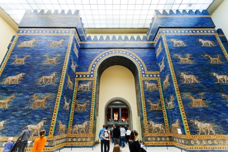 ishtar gate of babylon: BERLIN, GERMANY - OCTOBER 16: tourist in Ishtar Gate Hall of Pergamon museum in Berlin, Germany on October 16, 2013. Museum the most visited in Berlin it hosts more than 1.5million visitors per year
