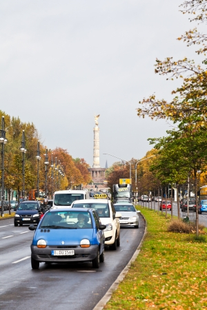 str: BERLIN, GERMANY - OCTOBER 17: view of Victory Column through Klingelhoferstrasse in Berlin , Germany on October 17, 2013. The column was relocated in Tiergarten from Konigsplatz in 1938.
