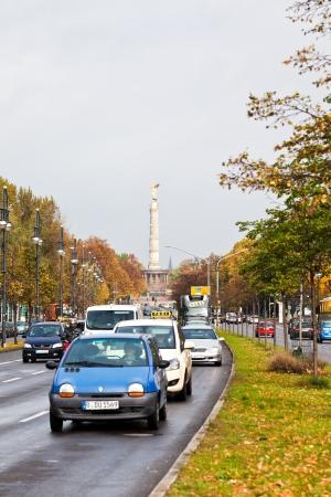 relocated: BERLIN, GERMANY - OCTOBER 17: view of Victory Column through Klingelhoferstrasse in Berlin , Germany on October 17, 2013. The column was relocated in Tiergarten from Konigsplatz in 1938.
