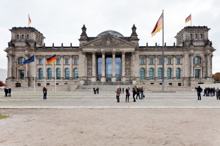 hosted: BERLIN, GERMANY - OCTOBER 17: front view of Reichstag building in Berlin, Germany on October 2013. The palace was opened in 1894, and since 1999 it hosted the modern German parliament - Bundestag