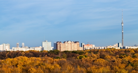 Moscow panoramic view with TV tower, houses and autumn trees and blue afternoon sky photo