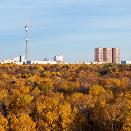 Moscow view with TV tower, houses and autumn trees and blue afternoon sky photo