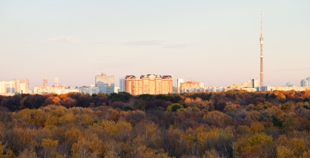 Moscow skyline with TV tower and pink autumn sunset over forest photo