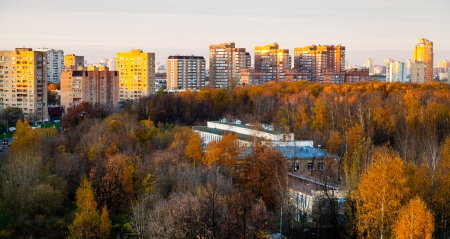 panoramic view of urban residential district in pink autumn sunset photo