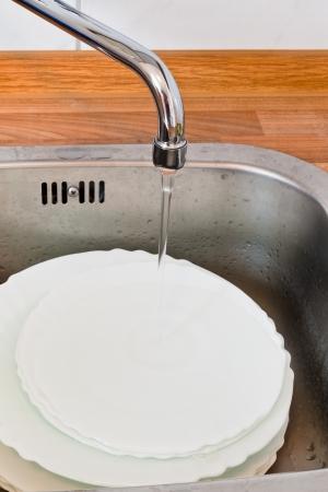 washup: wash-up in metal washbasin in kitchen