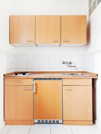white kitchen with simple furniture set photo