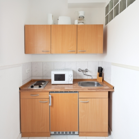 simple kitchen with furniture set and kitchen equipment photo