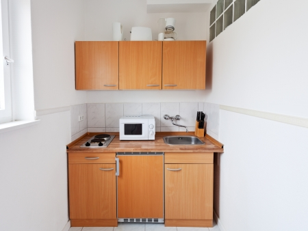small kitchen with furniture set and kitchen equipment photo