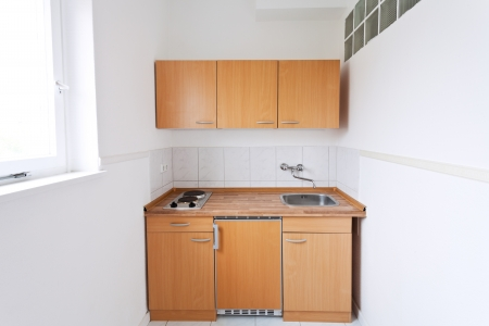 simple kitchen with window and furniture set photo