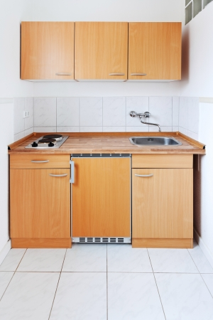 small kitchen with simple furniture set photo