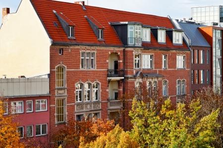 str: brick facade of residential building of 19th century in Berlin in autumn morning
