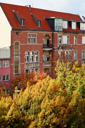 str: brick facade of residential house of 19th century in Berlin in autumn morning