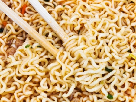 instantnudeln: eating of cooked instant noodles by wooden chopsticks close up Stock Photo