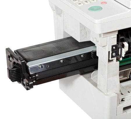 consumables: inserting of toner cartridge in office multifunctional device close up