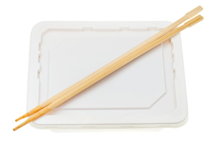 instantnudeln: polystyrene cup with instant noodles and wooden chopsticks