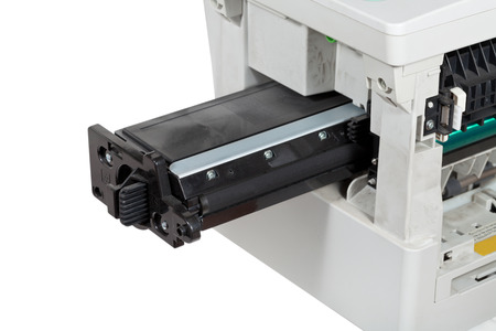 refilling: insert of toner cartridge in office multifunctional device close up