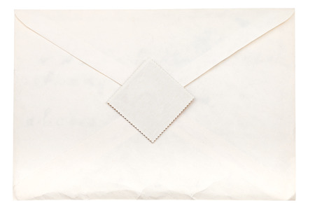 closed paper envelope sealed by postage stamp isolated on white background photo