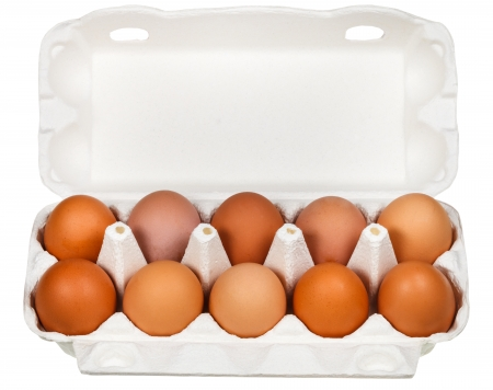chicken eggs in cardboard package isolated on white background photo