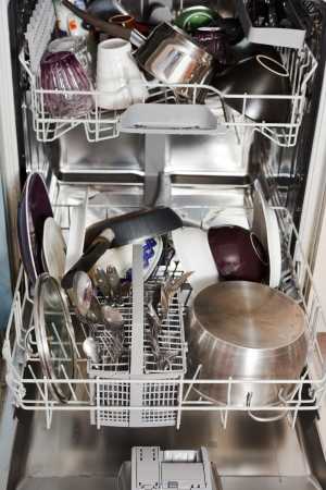 dirty cookware in open home dishwasher photo