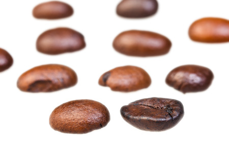focus on foreground: rows from roasted coffee beans with focus foreground