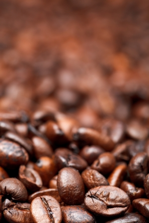 focus on foreground: background from many roasted coffee beans with focus foreground Stock Photo