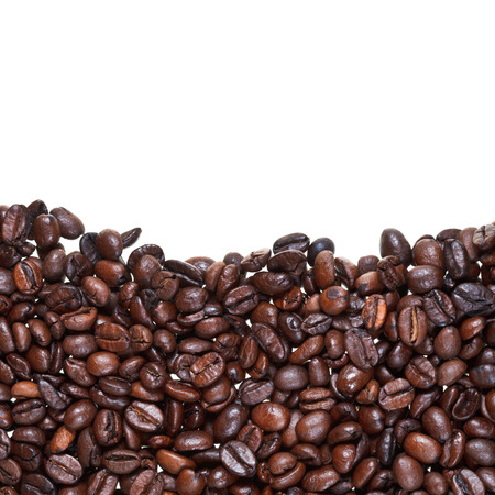 level from roasted coffee beans close up on white background photo