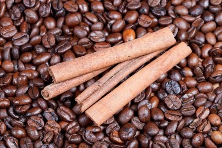 'cinnamon bark': cinnamon bark on roasted coffee beans close up