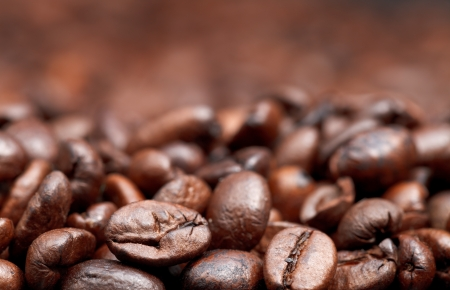 focus on foreground: roasted coffee beans background with focus foreground