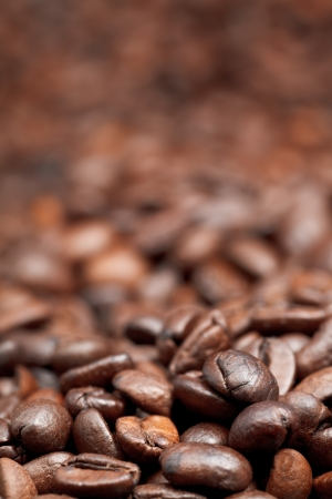 focus on foreground: heap of roasted coffee beans background with focus foreground Stock Photo