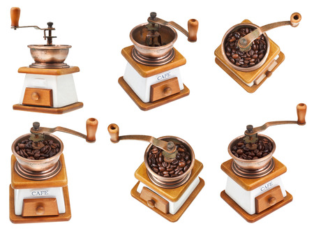 set of vintage manual copper coffee mill isolated on white background photo