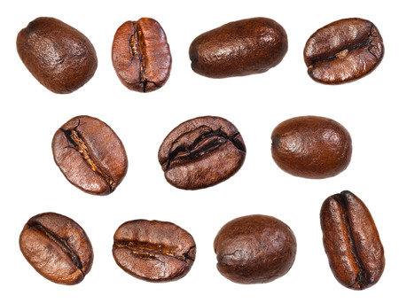 set of roasted coffee beans isolated on white background photo