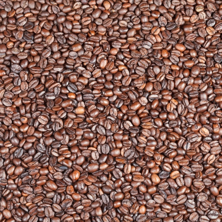 background from many dark roasted coffee beans photo