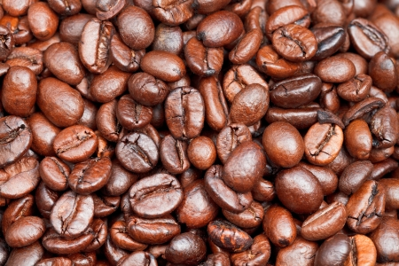 background from many light roasted coffee beans close up photo