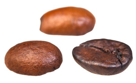 three roasted coffee beans isolated on white background photo