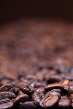 focus on foreground: strong roasted coffee beans black background with focus foreground Stock Photo