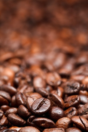 focus on foreground: red roasted coffee beans background with focus foreground Stock Photo