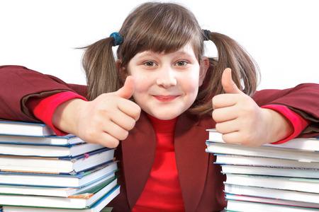 schoolwork: joyful schoolgirl did schoolwork and shows thumb-up