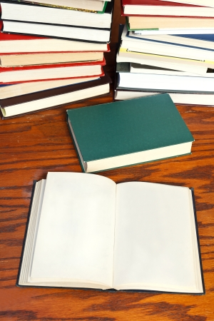 blank open book and closed book on wooden table photo