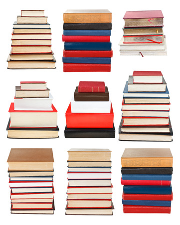 set from piles of different sizes books isolated on white background photo
