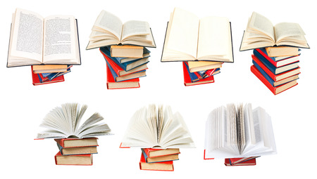 set from fan opened books on top of stack of books isolated on white background photo