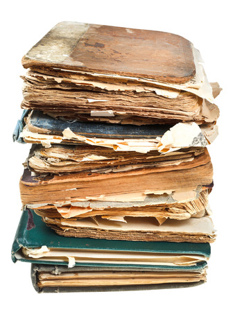 stack of retro books with pages torn out isolated on white background photo